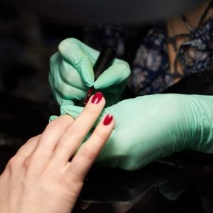 woman-paint-nails-client-manicure-nails-hand-care_86390-1052-1.jpg